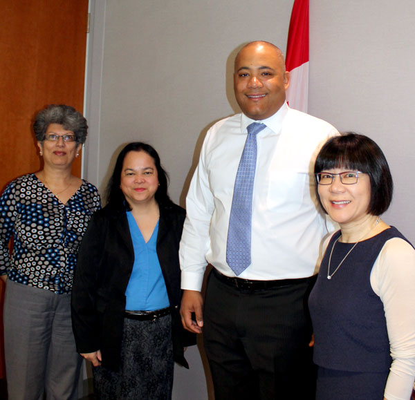 Executive Director Zubeida Ramji, board member Flordeliz Dandal and board Chair Amy Go with Minister Michael Coteau